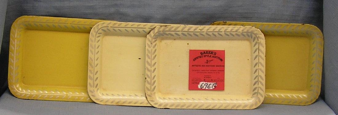 Group of four vintage cream colored serving trays