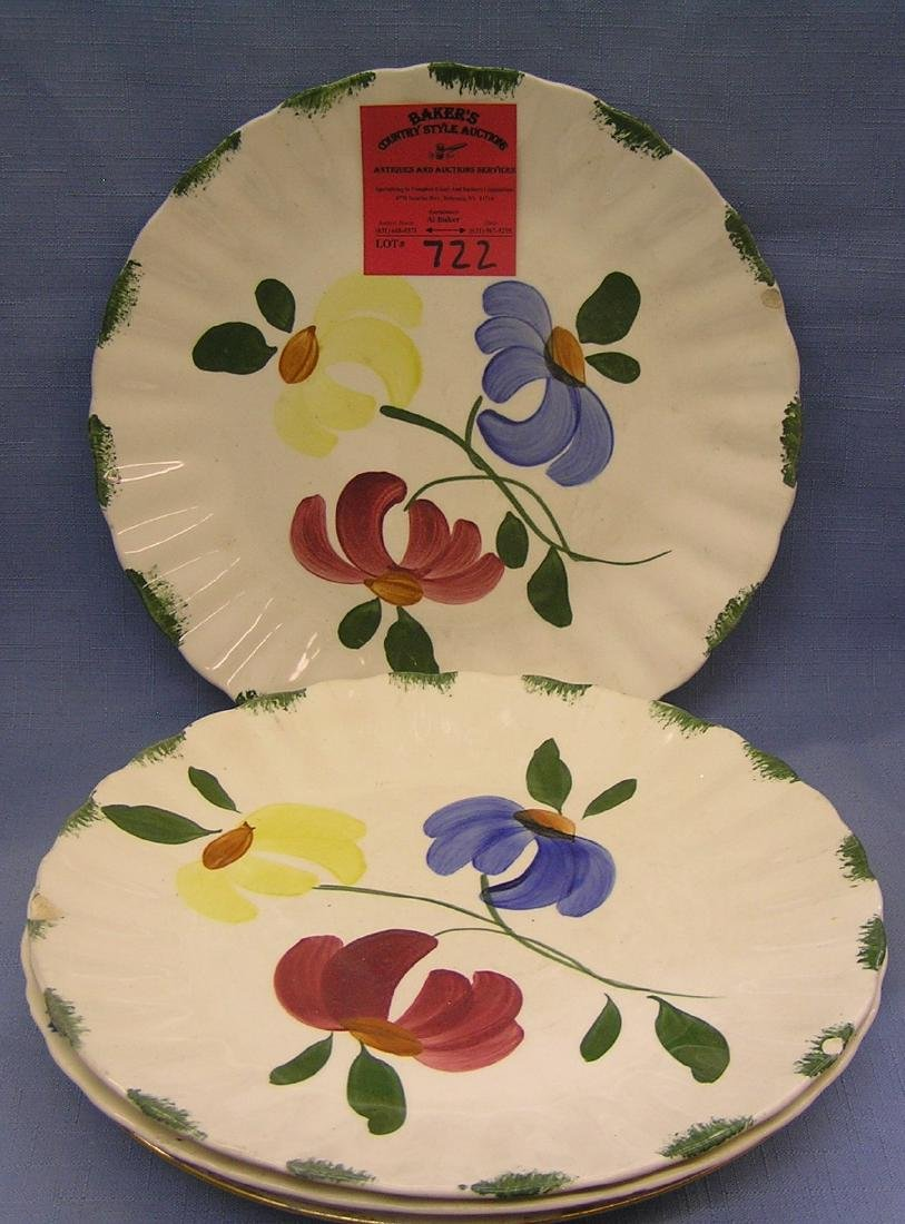 Group of four floral decorated serving plates