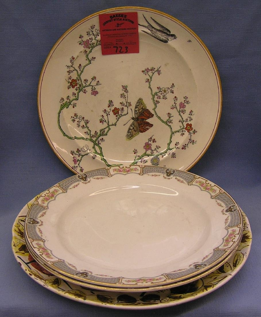 Group of 4 floral decorated serving plates