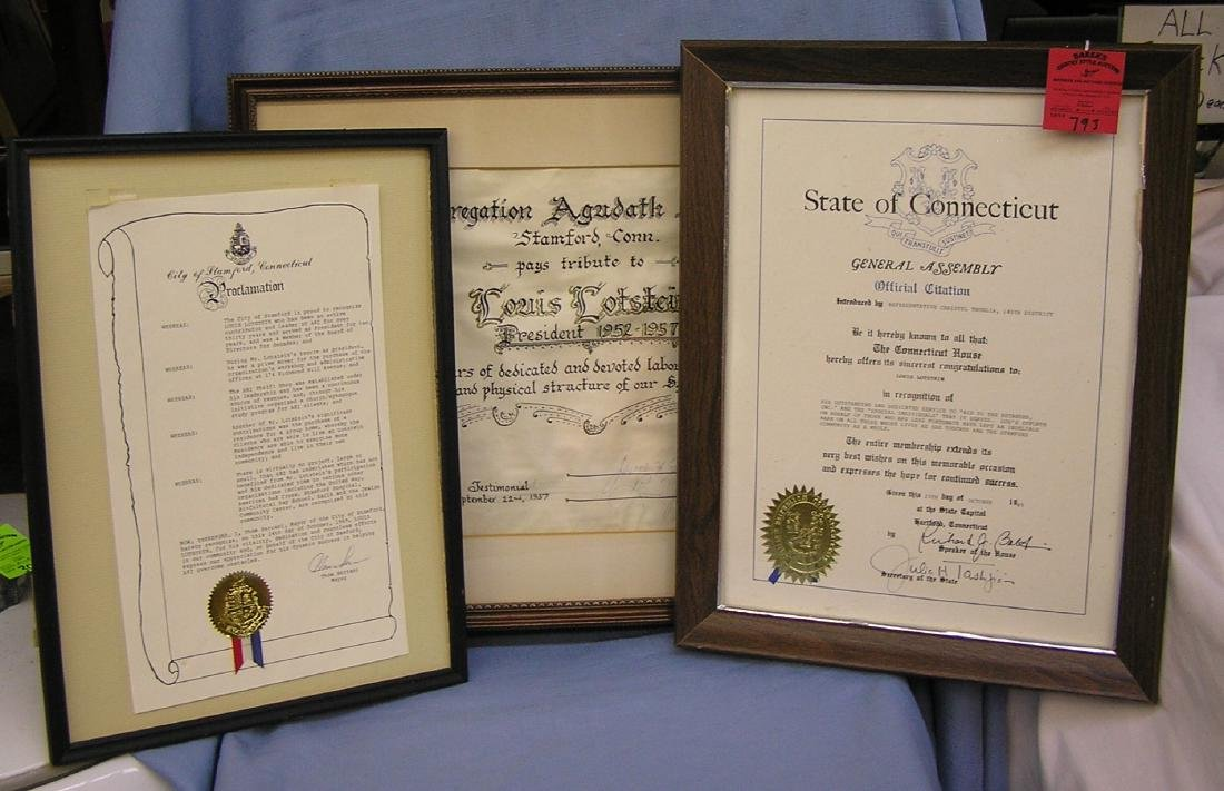 Three framed awards and proclamations