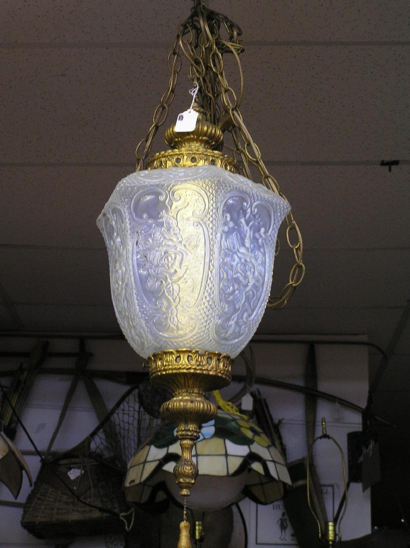 Vintage chandelier with floral decorated glass