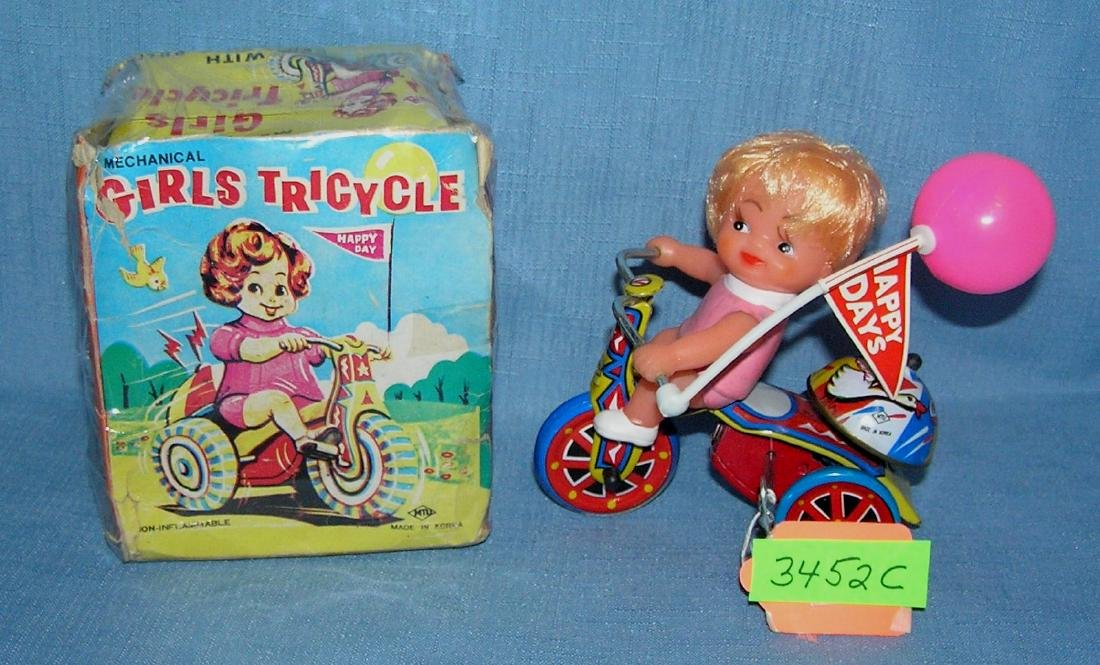 All tin windup Girl on Tricycle toy