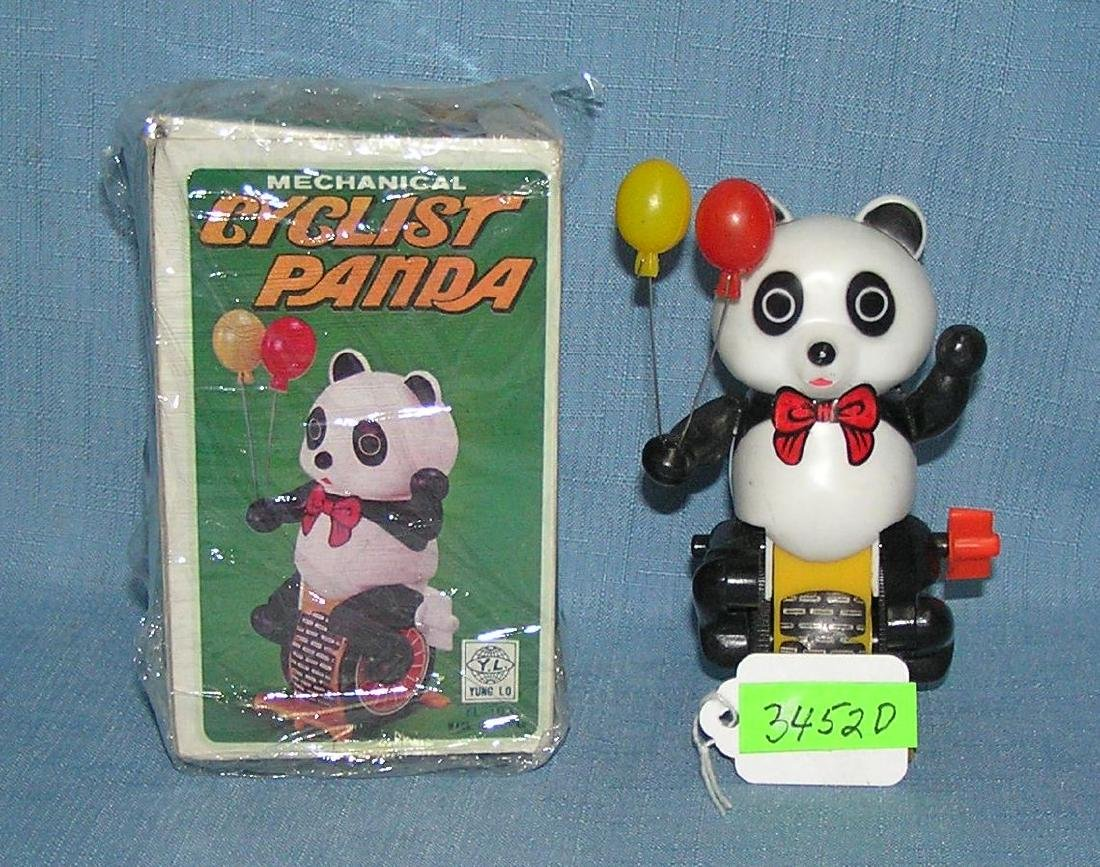 Windup mechanical panda cyclist