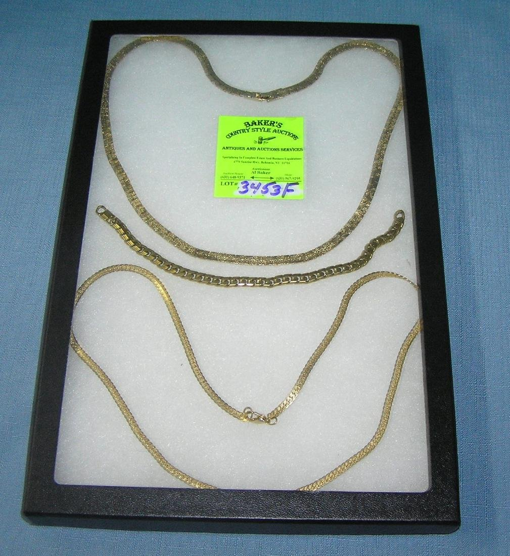 Group of gold plated necklaces and bracelet