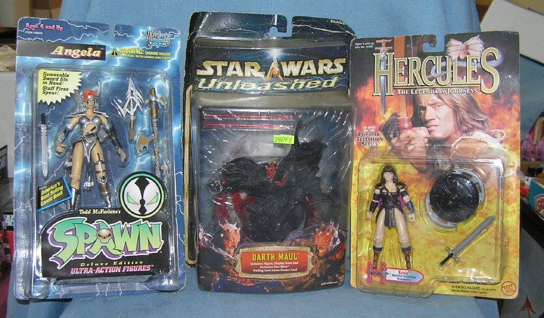 Group of 3 mint on card action figures