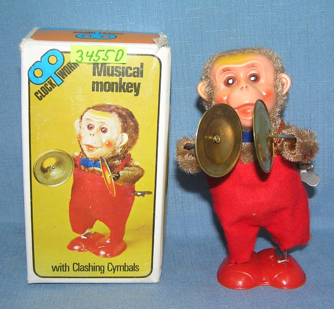 Clock work wind up musical monkey
