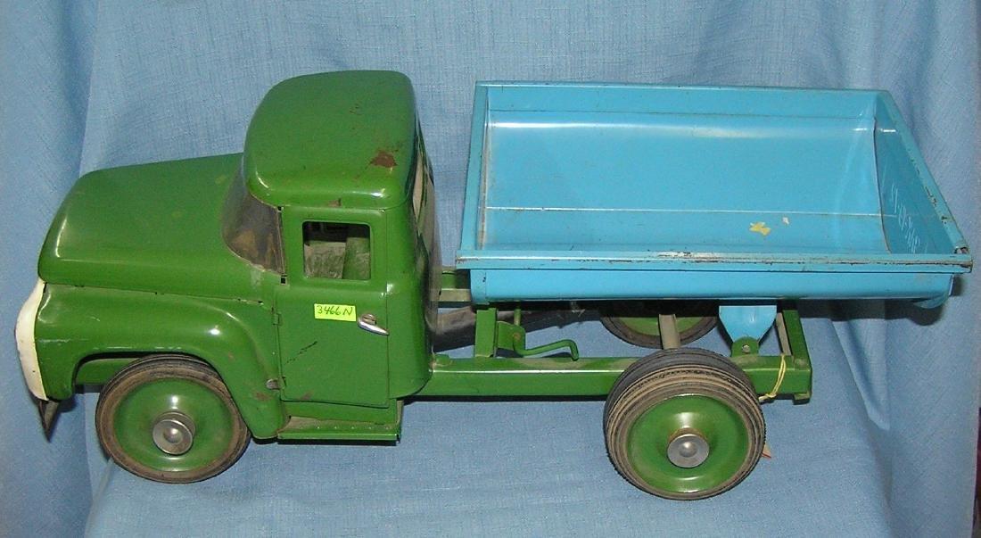 Antique pressed steel hydraulic dump truck