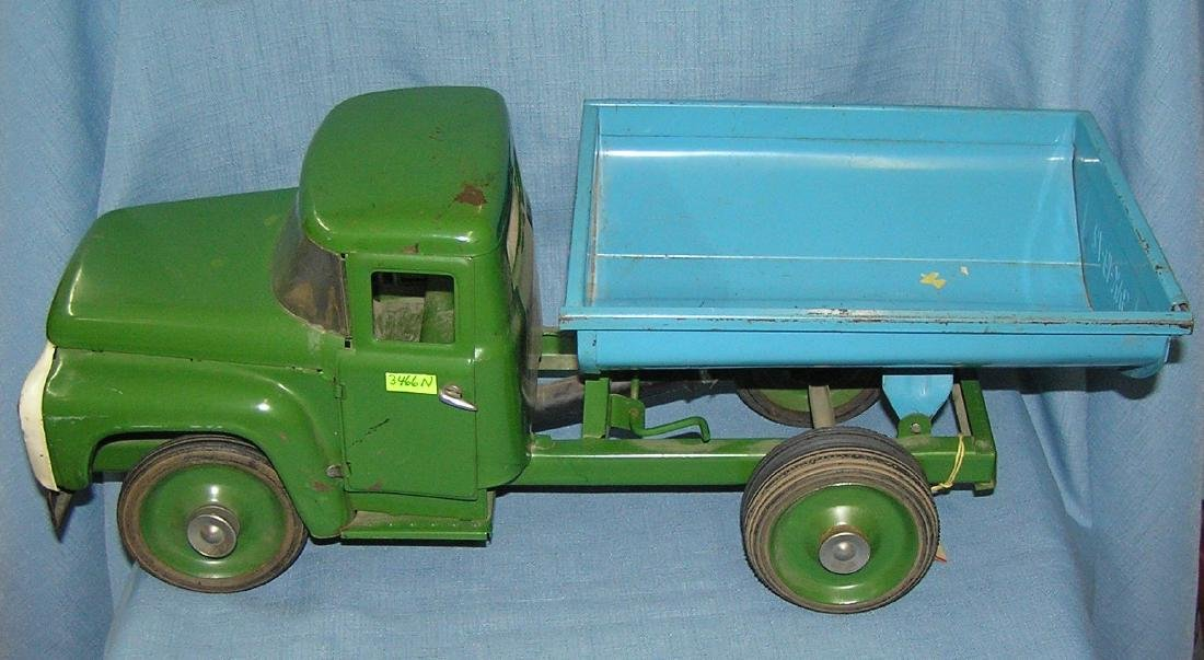Antique pressed steel hydraulic dump truck