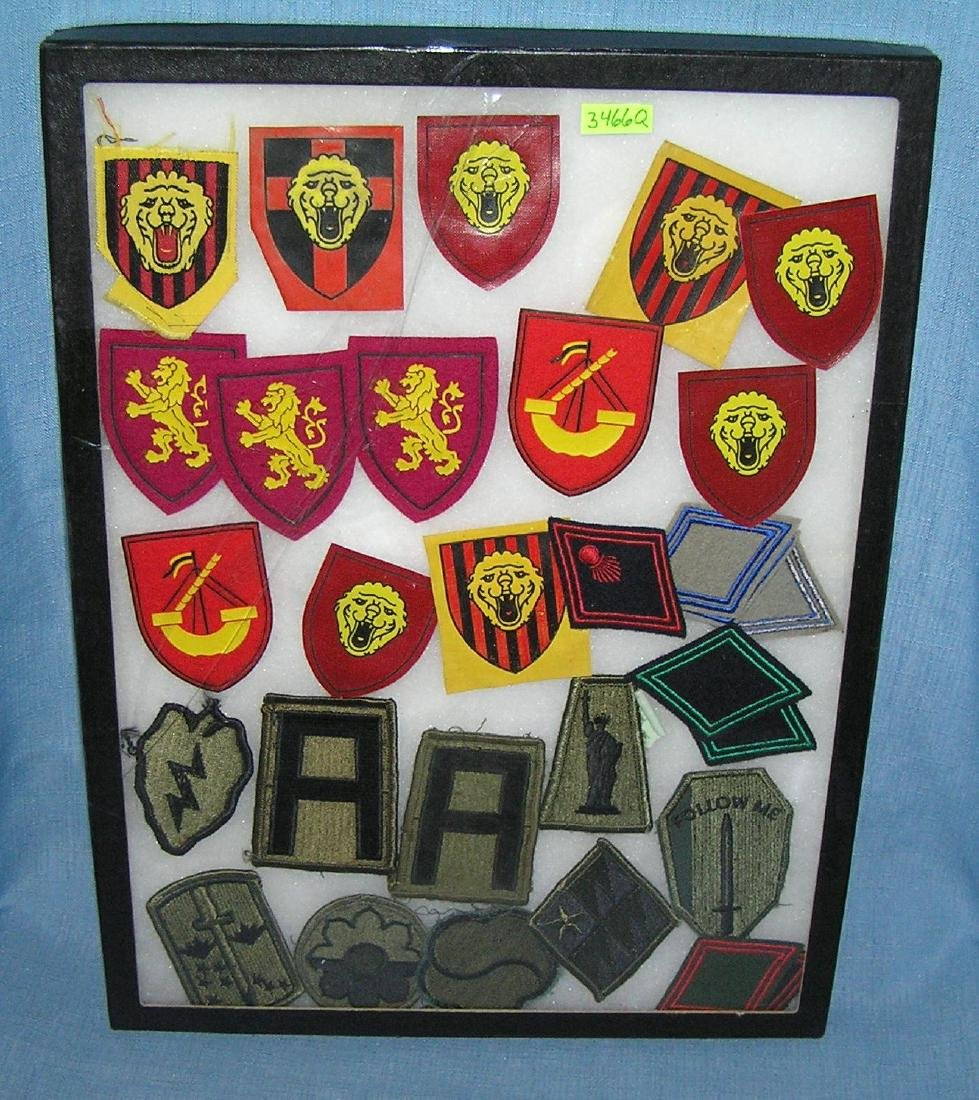 Collection of vintage military patches and more