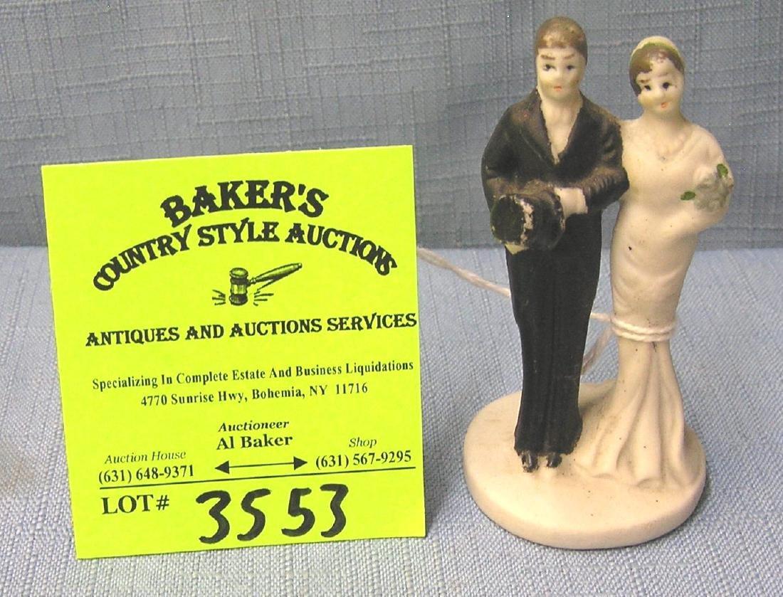 Vintage bisque bride and groom figurine
