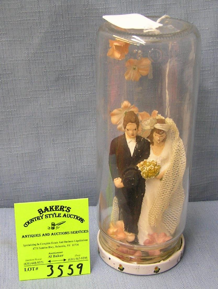 Larger chalkware bride and groom figure