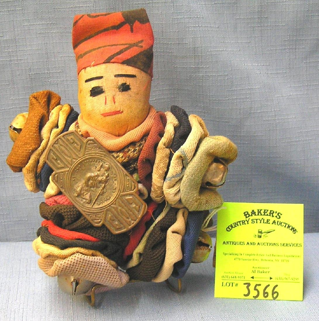 Antique doll with bells and decorations
