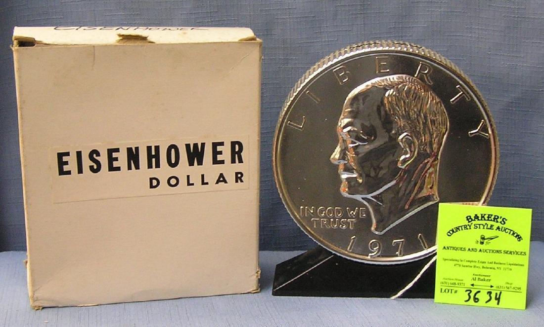 Vintage cast metal Eisenhower dollar coin bank