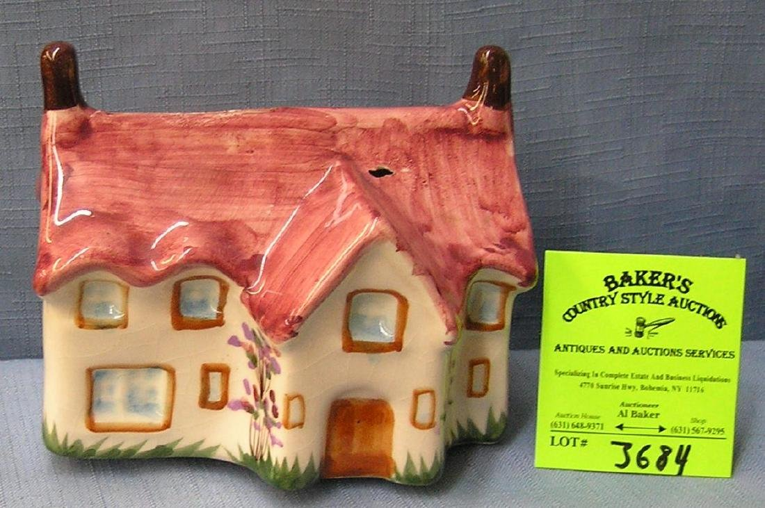 Painted porcelain cottage bank