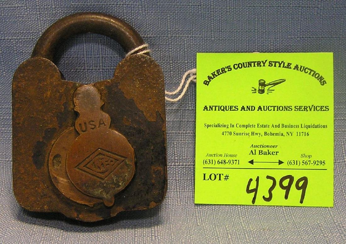 Antique cast iron, steel & brass padlock marked Creo