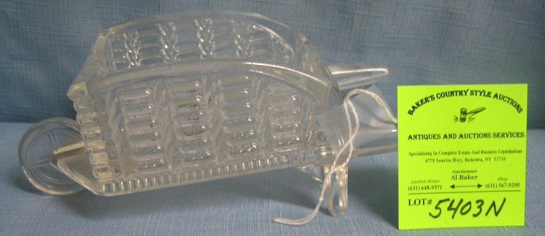 Early glass farm house wheelbarrow candy container