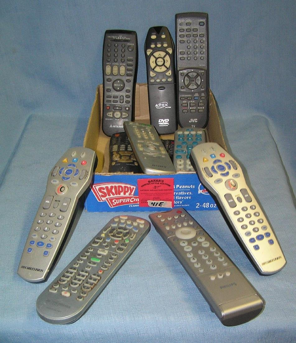 Box full of TV and DVD remote controls