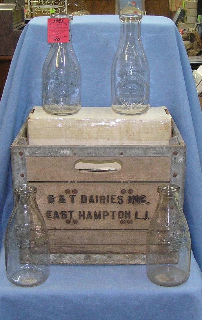 Group of antique milk bottles with crate