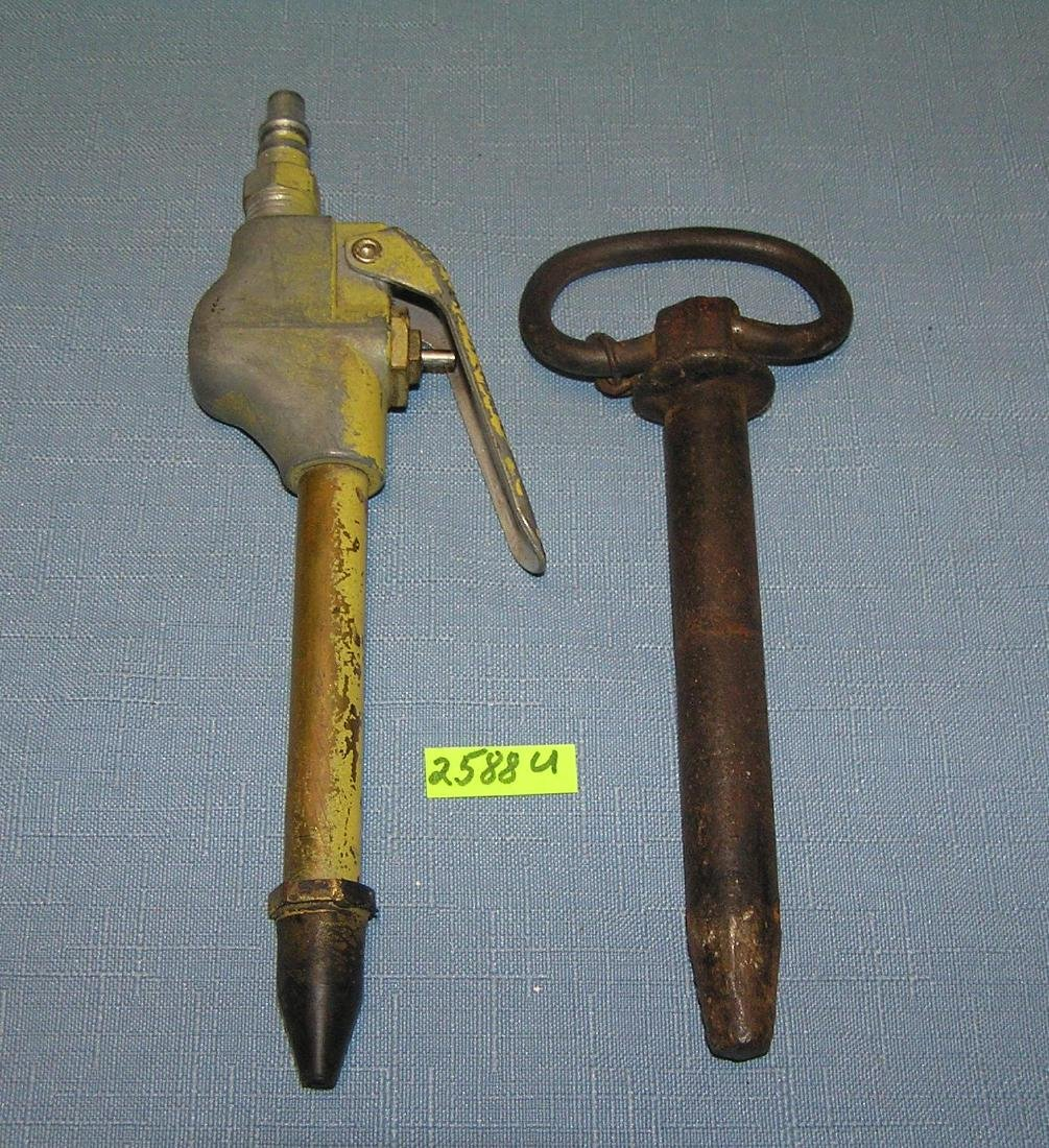 Milton air nozzle and an antique iron push pin