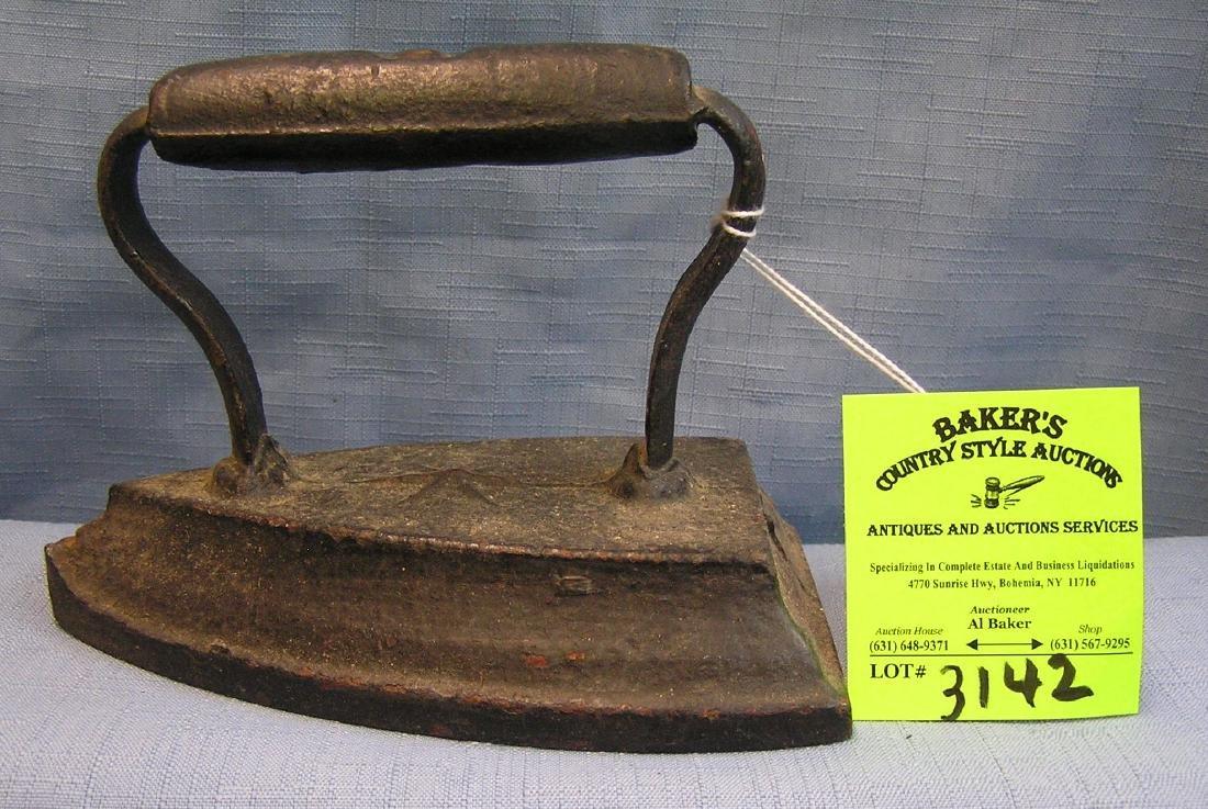 Antique cast iron clothes iron