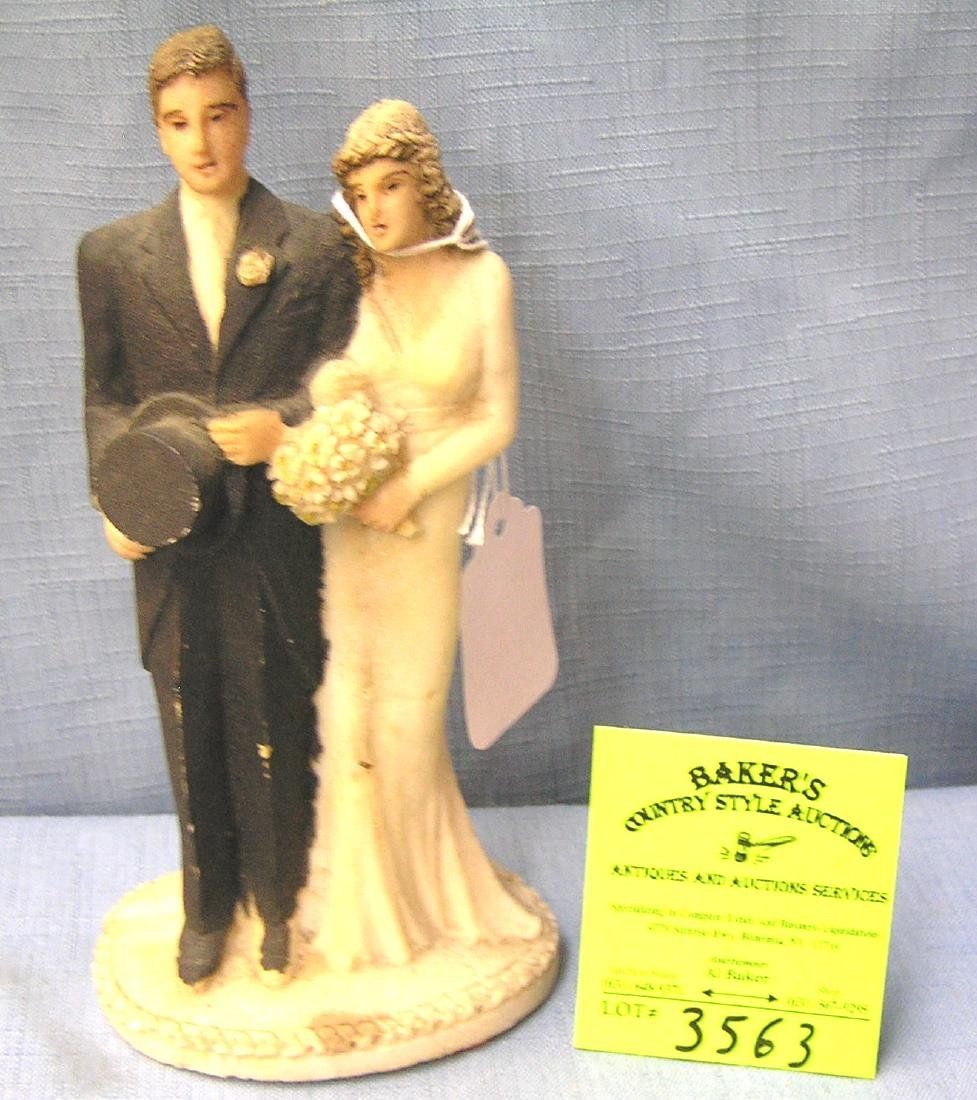 Larger composition bride and groom figure
