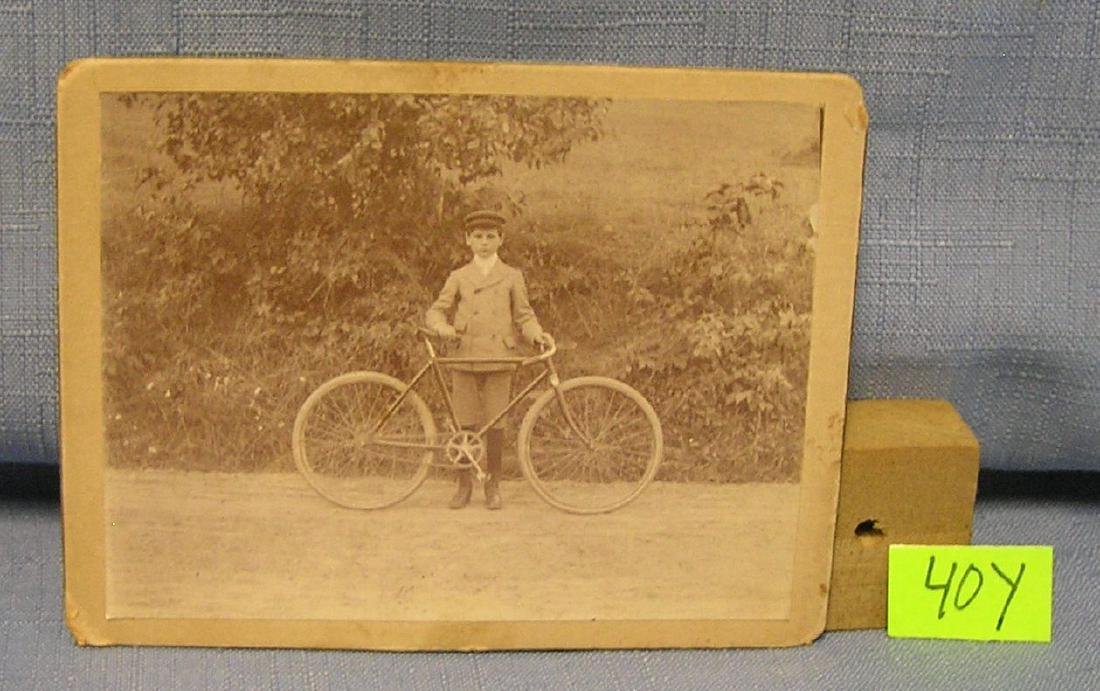 Great early bicycle and rider photograph