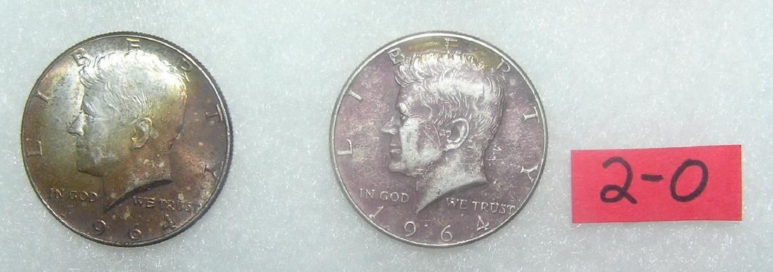 Pair of John F Kennedy silver half dollar coins