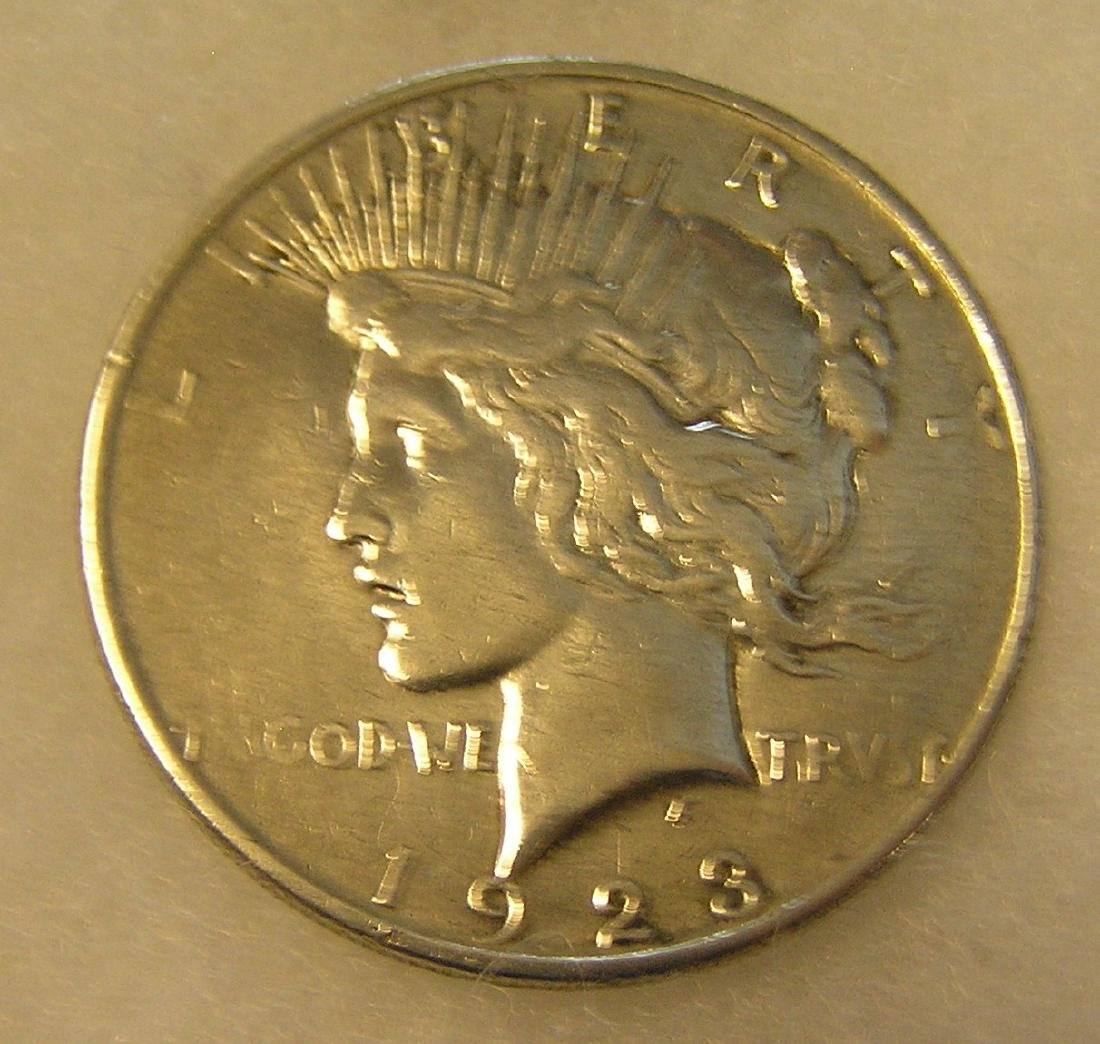1923D Peace silver dollar in very good plus condition