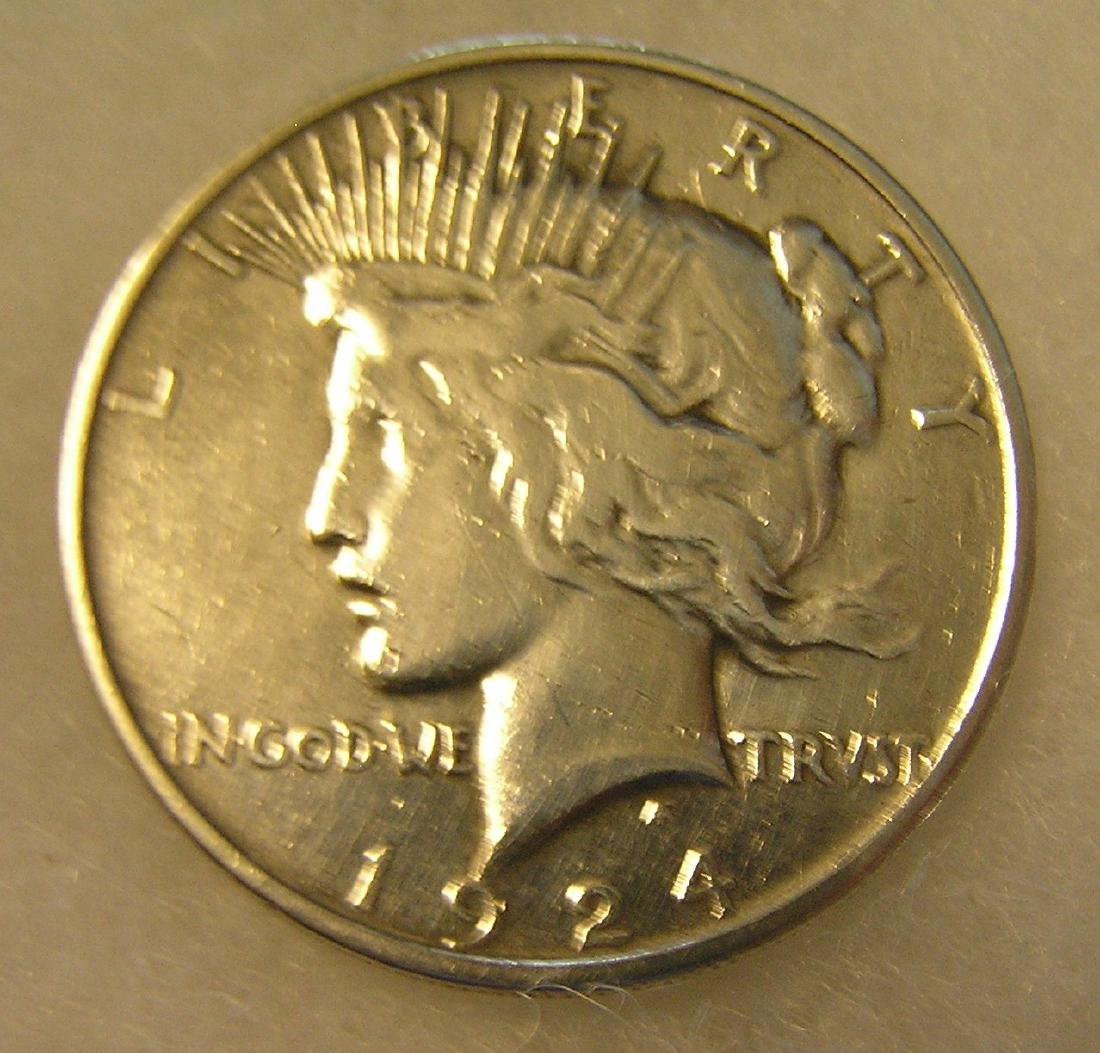 1924 Lady Liberty Peace silver dollar in very good