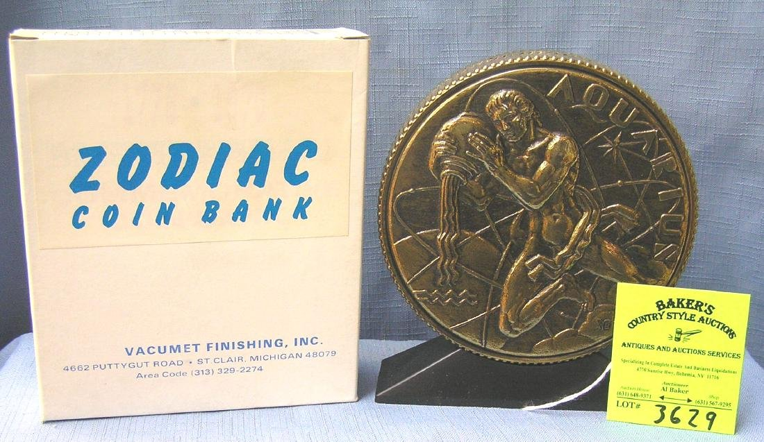 Vintage cast metal zodiac bank Aquarius