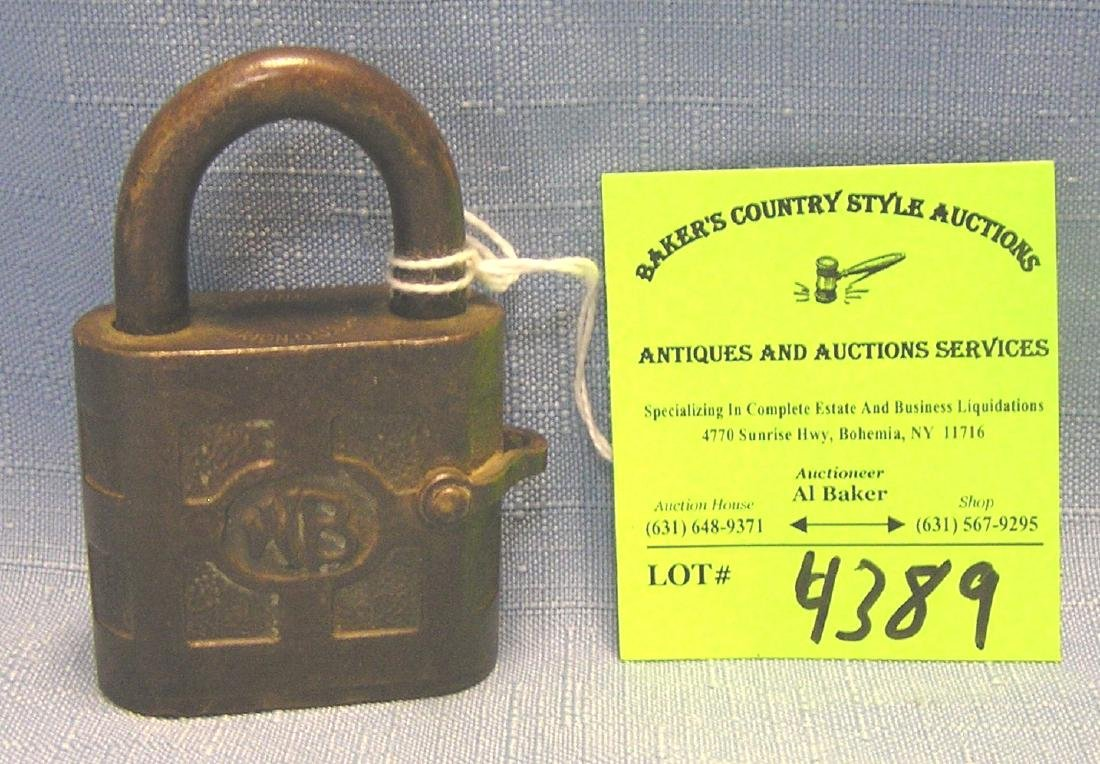 Antique solid brass padlock marked WB