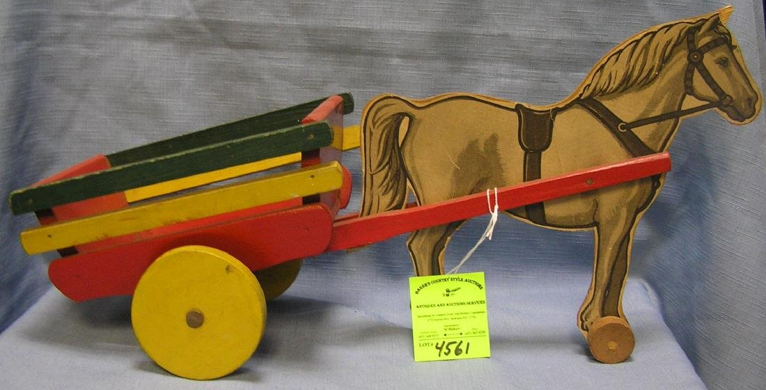Early wooden horse drawn cart pull toy