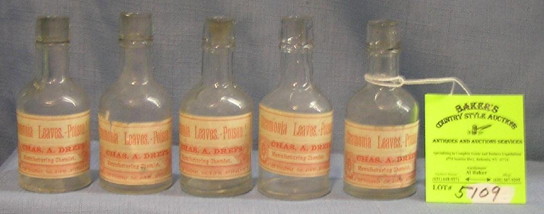 Group of five early poison bottles