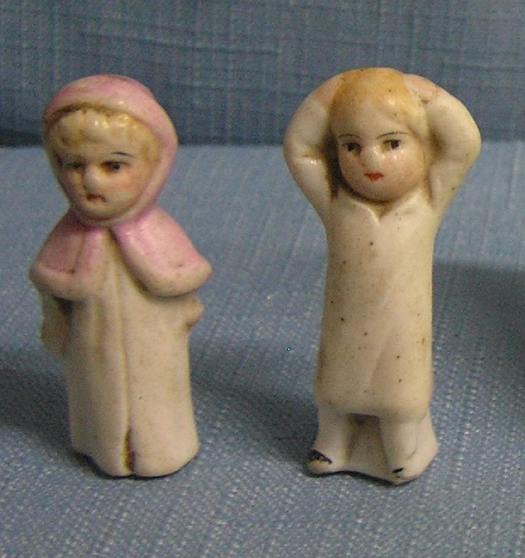 Pair of miniature porcelain dolls