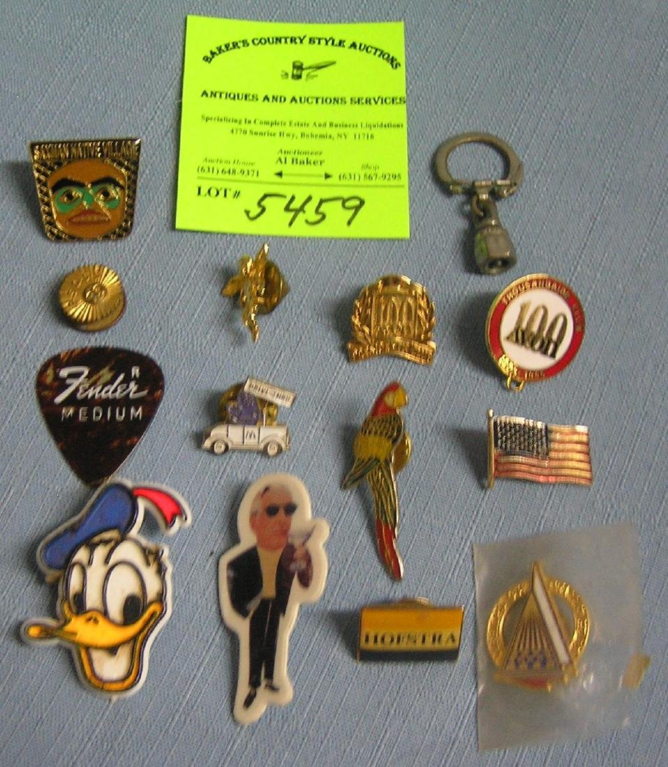 Group of vintage collectible pins and more