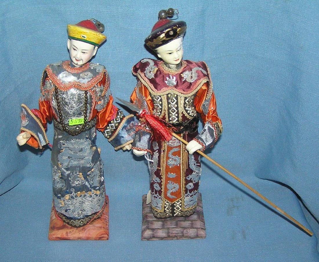 Pair of antique oriental dolls