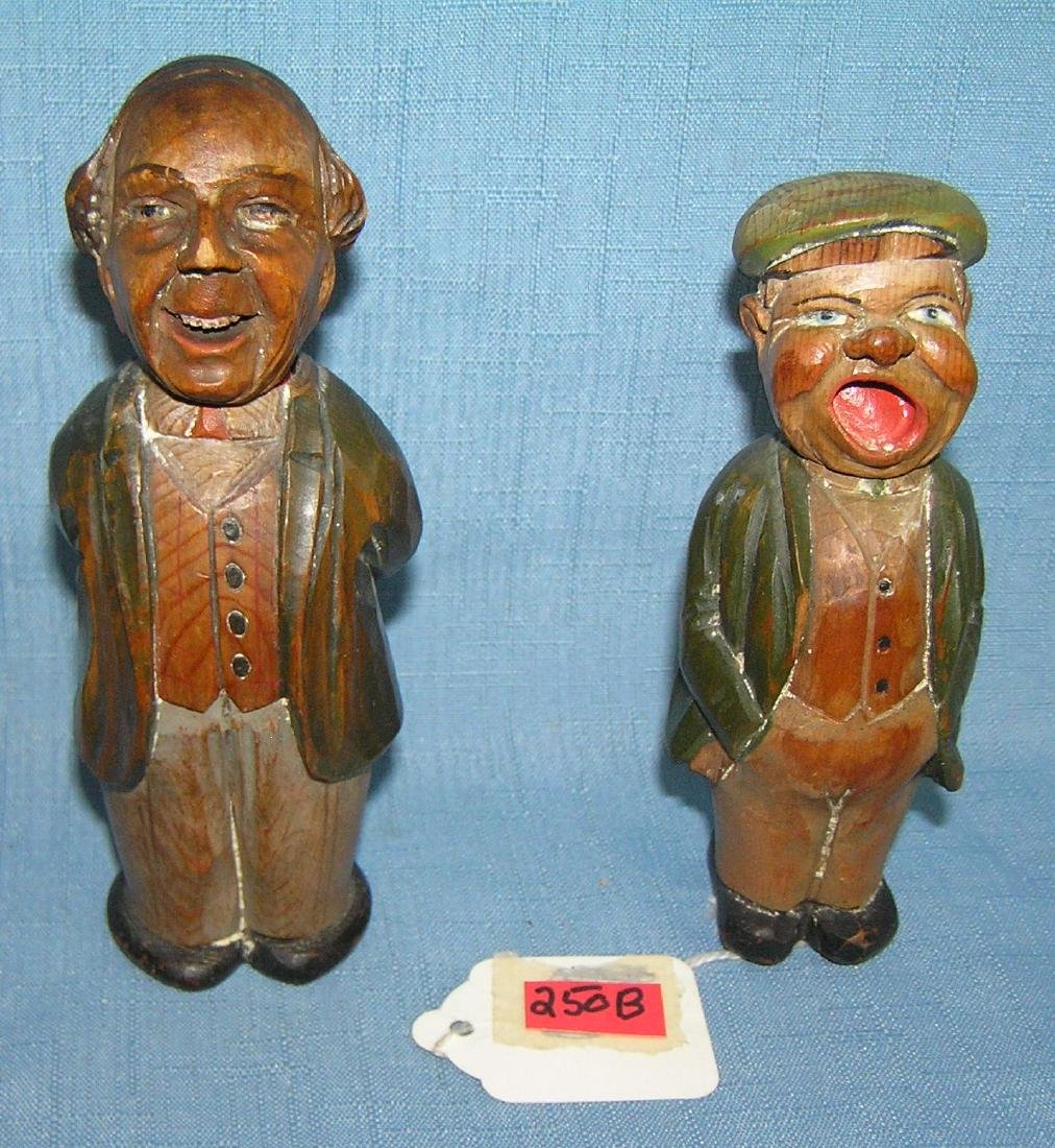 Pair of hand carved gentlemen figures signed Anri