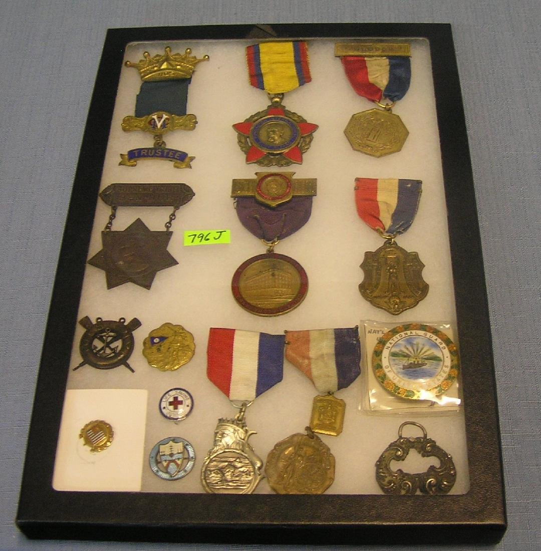 Group of antique medals, badges, and awards