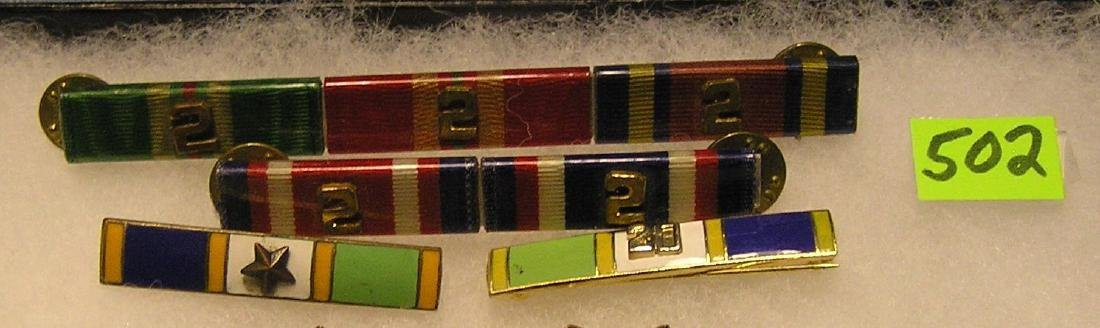 Collection of seven military bars