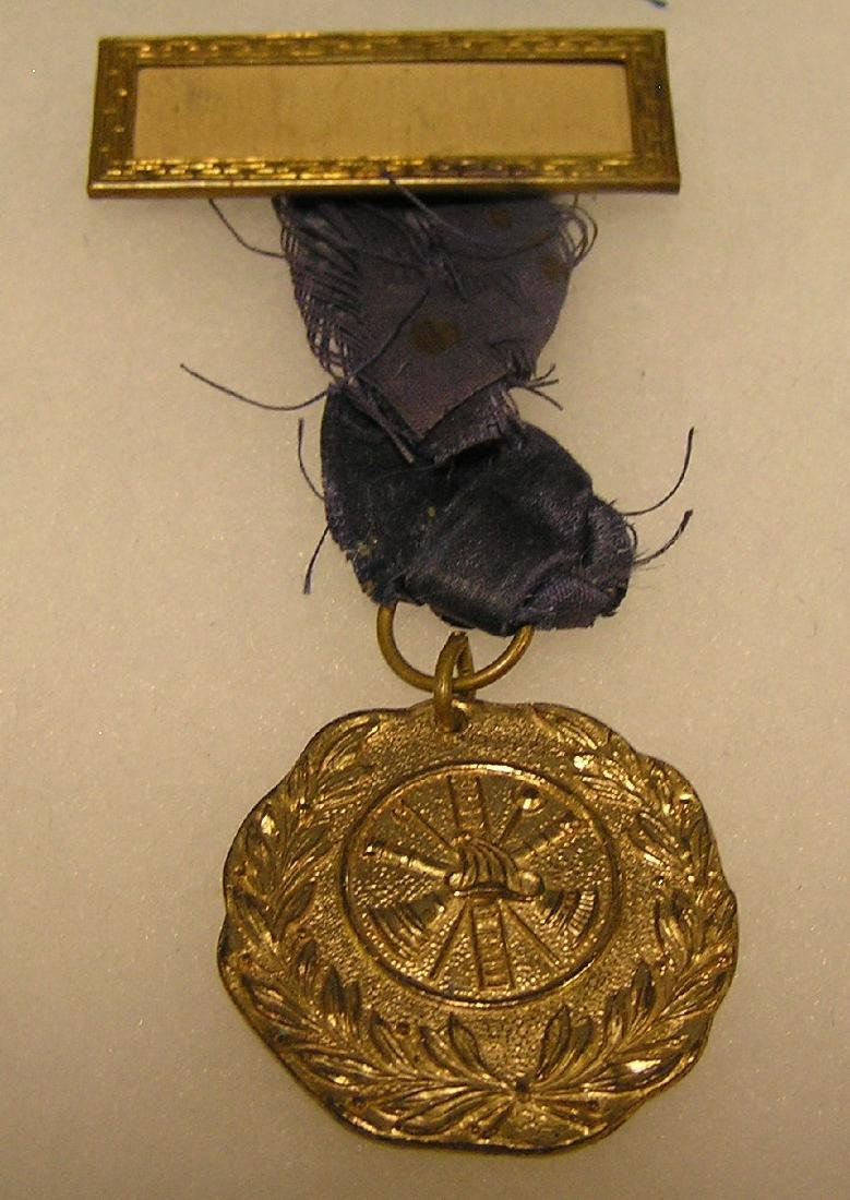 Antique fire department medal and ribbon set