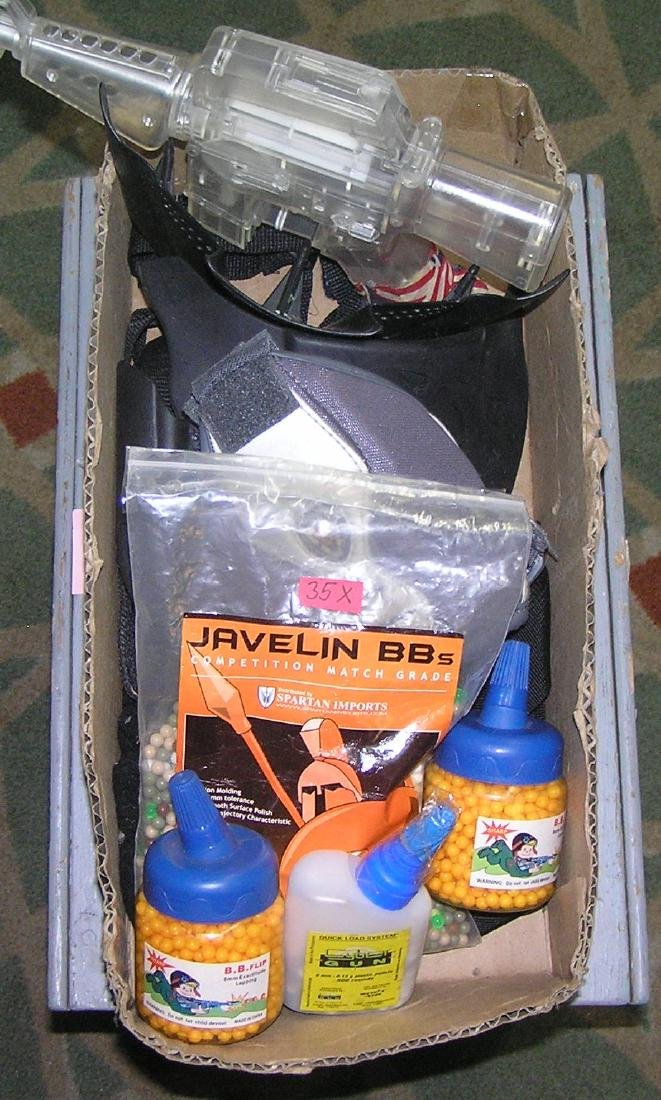 Box full of Airsoft BB's, accessories and more