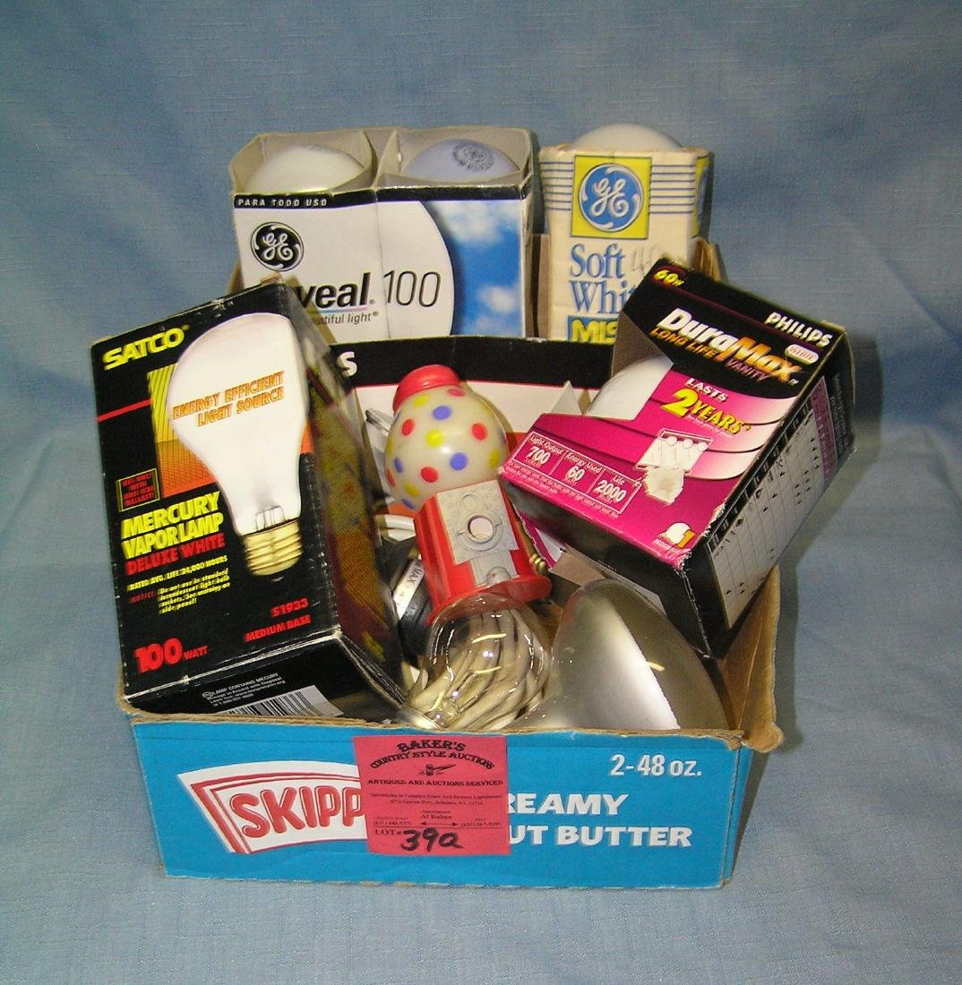 Box full of estate light bulbs and accessories