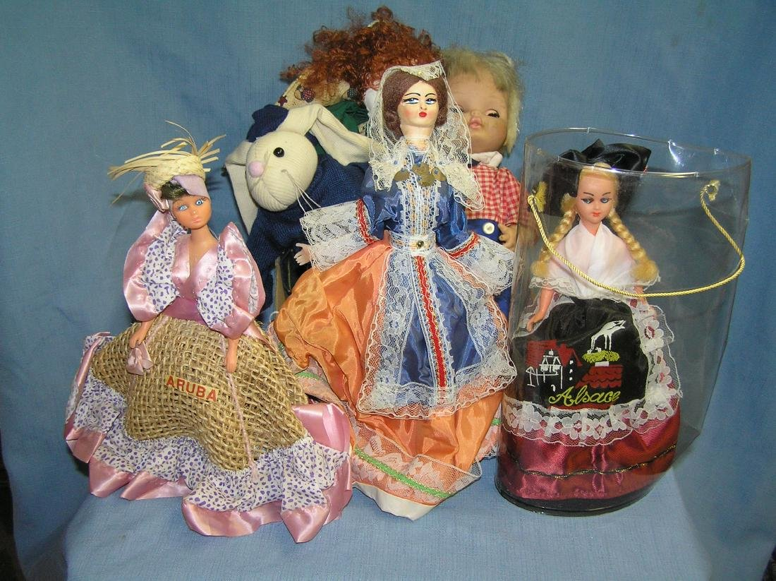 Box full of collectible dolls and more