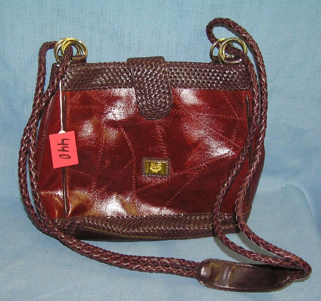 Quality maroonish brown leather ladies pocket book
