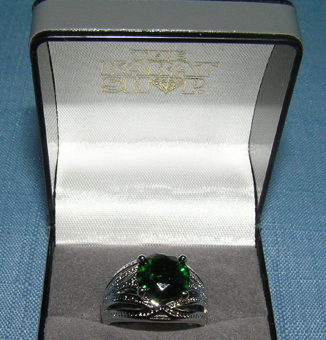 Quality costume jewelry ring with emerald stone
