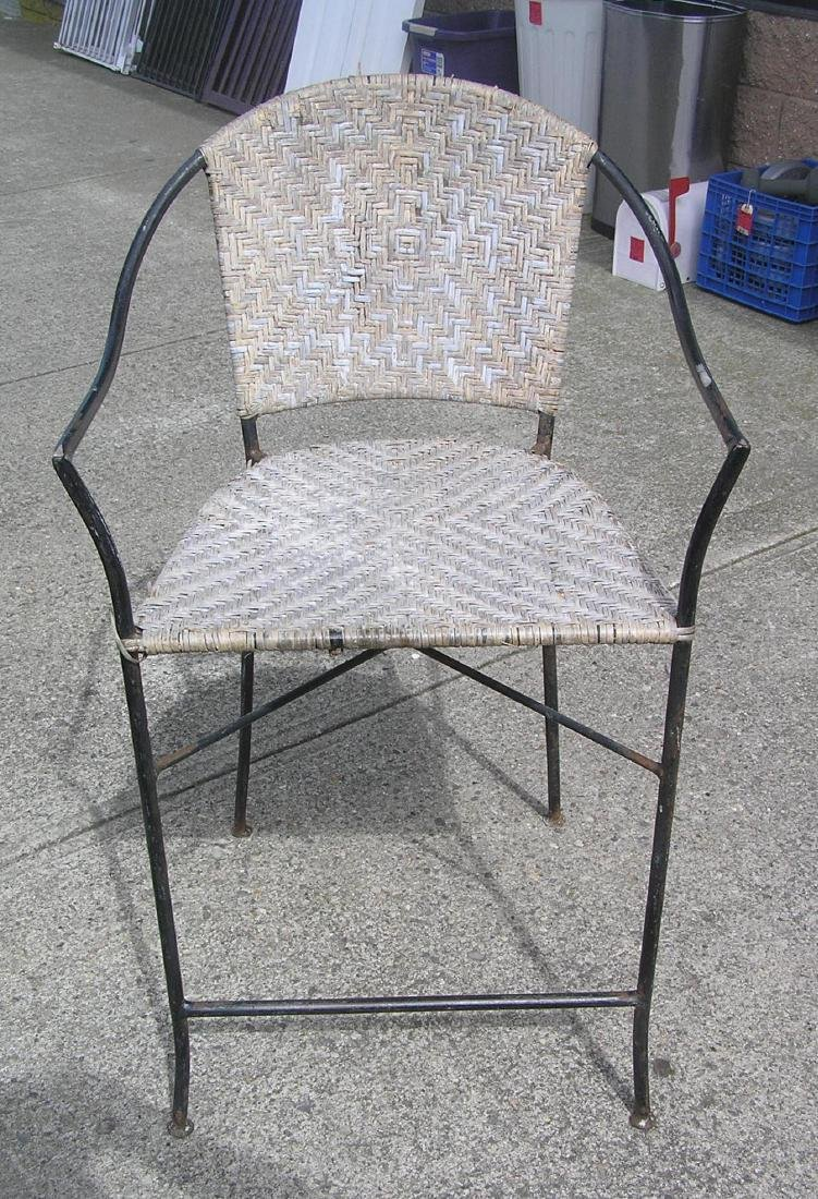 Wrought iron and wicker chair