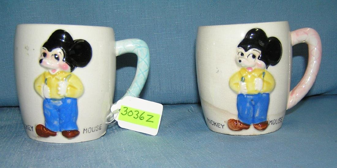 Pair of great early Mickey Mouse milk mugs