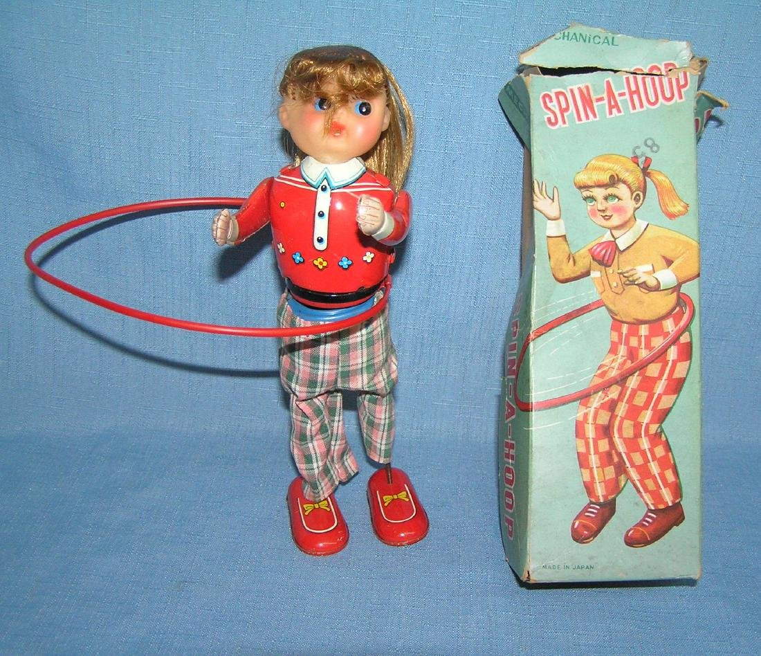Spin-A-Hoop wind up all tin mechanical toy