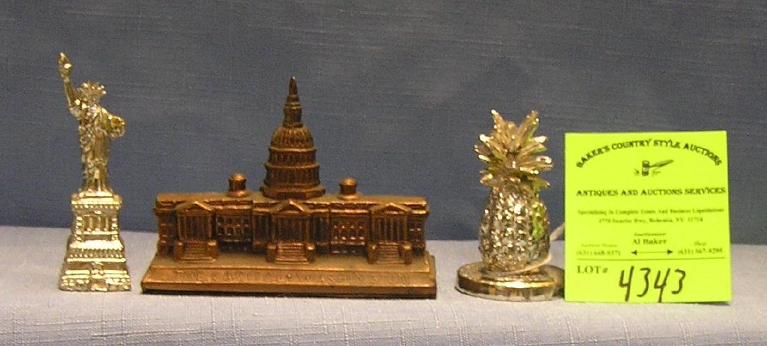 Group of three souvenir paper weights