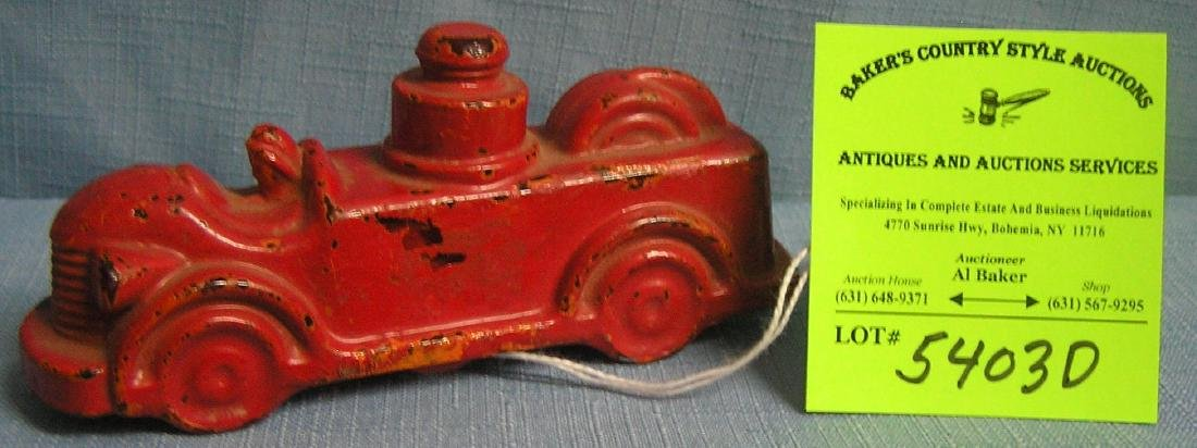Great early painted glass fire truck candy container